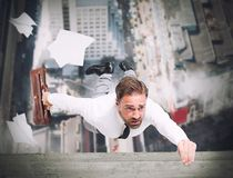 Businessman is going to fall Royalty Free Stock Images