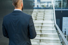 Businessman going to his work. Back view. Royalty Free Stock Photos