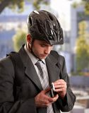 Businessman going to work by bike Stock Image