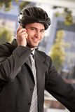 Businessman going to work by bike Stock Photos