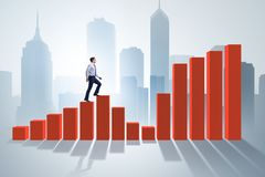 The businessman going up the bar chart in growth concept. Businessman going up the bar chart in growth concept Royalty Free Stock Photography