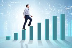 The businessman going up the bar chart in growth concept. Businessman going up the bar chart in growth concept Stock Photo