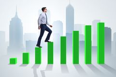 The businessman going up the bar chart in growth concept. Businessman going up the bar chart in growth concept Stock Photos