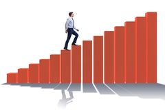The businessman going up the bar chart in growth concept. Businessman going up the bar chart in growth concept Royalty Free Stock Image