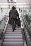 A businessman going up the escalator. Stock Photo