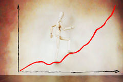 Businessman going up on rising graph Royalty Free Stock Photography