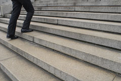 Businessman going up stairs Stock Image