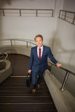 Businessman going up the stairs Stock Images