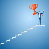 Businessman going up to trophy and success. Stair step to success Royalty Free Stock Images