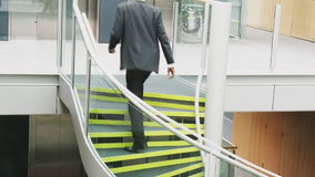 Businessman going upstairs in a building office Royalty Free Stock Images