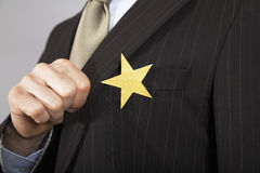 Businessman With Gold Star On Suit Stock Photography