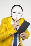 Businessman in a gold suit, performs quietly gesture stock image