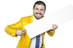 Businessman in gold suit shows a place for your text Stock Images