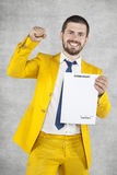 Businessman in a gold suit is successful, a new contract royalty free stock photos