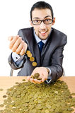 Businessman with golden coins Stock Images