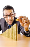 Businessman with golden coins Royalty Free Stock Image