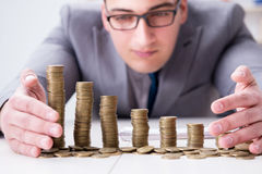 The businessman with golden coins in business growth concept Stock Image