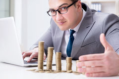 The businessman with golden coins in business growth concept Royalty Free Stock Image