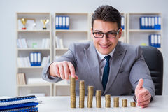 The businessman with golden coins in business growth concept Royalty Free Stock Photo