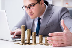 The businessman with golden coins in business growth concept Stock Photography