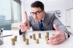 The businessman with golden coins in business growth concept Royalty Free Stock Images