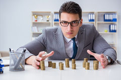 The businessman with golden coins in business growth concept. Businessman with golden coins in business growth concept Stock Photos