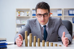 The businessman with golden coins in business growth concept Royalty Free Stock Photos
