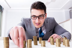 The businessman with golden coins in business growth concept Stock Photo