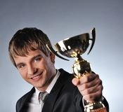 businessman with a golden cup Royalty Free Stock Images