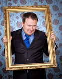 Businessman in golden frame on wallpapers Royalty Free Stock Photo
