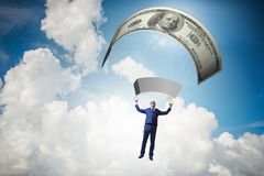The businessman in golden parachute concept Royalty Free Stock Photo