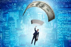 The businessman in golden parachute concept Stock Photography