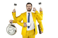 Businessman in a golden suit is very multipurpose. Business man in a golden suit is very multipurpose Royalty Free Stock Image