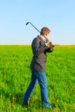 Businessman with a golf club Stock Photography
