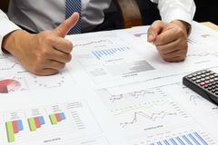 Businessman good idea summary report  market . Businessman good idea summary report  market with calculate about market cost at table office office Stock Photography