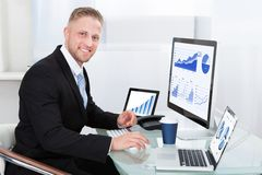 Businessman with good performance graph Stock Photos