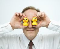 Businessman goofing off Stock Images