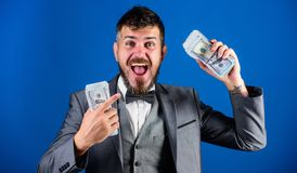 Businessman got cash money. Get cash easy and quickly. Cash transaction business. Man happy winner rich hold pile of. Dollar banknotes blue background. Easy stock photography