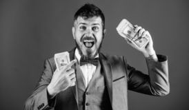 Businessman got cash money. Get cash easy and quickly. Cash transaction business. Man happy winner rich hold pile of. Dollar banknotes blue background. Easy royalty free stock photo