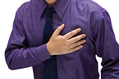 Businessman got a heart attack. Businessman touch is chest for heart attack concept Royalty Free Stock Image