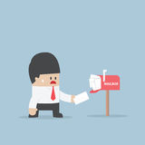 Businessman got a lot of mail in mailbox Royalty Free Stock Image
