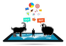 Businessman grab a goat to match a sheep on tablet online and set icon business . Businessman grab a goat to match a sheep on tablet online and set icon Royalty Free Stock Images