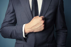 Businessman grabbing his jacket Royalty Free Stock Photography
