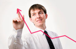 Businessman with a graph Stock Images