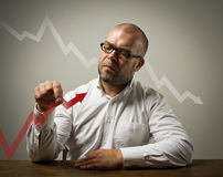 Businessman and a graph Royalty Free Stock Photo