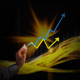Businessman with graph symbols coming from hand Stock Photo