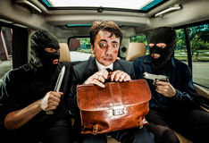 Businessman grasped in hostages. Royalty Free Stock Image