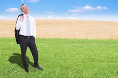 Businessman in the grass Stock Photography