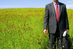 Businessman in grass. Royalty Free Stock Photo