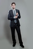 Businessman in gray suit thinking or dreaming Royalty Free Stock Images